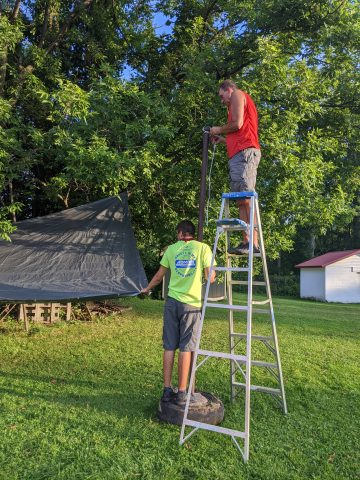 Eric Vreeland and his sons put up tarps for our outdoor learning spaces.